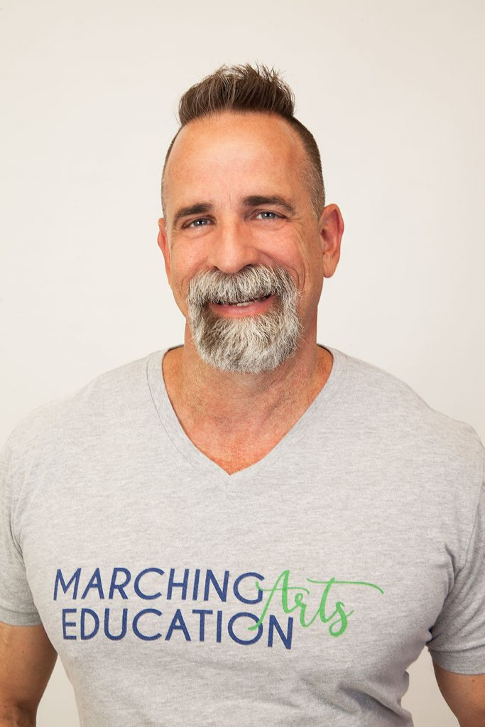 Tim Hinton portrait in Marching Arts Education shirt