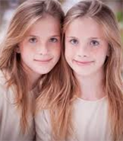 Gertraud and Sonya, Twin youngest daughters of Commisar Igor Urnst Ptolus the City by the Spire